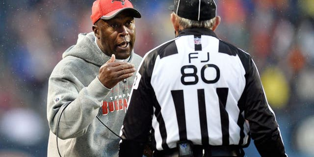 CHICAGO, IL - NOVEMBER 23: Head coach Lovie Smith of the Tampa Bay Buccaneers (L) talks with field judge Greg Gautreaux during the fourth quarter against the Chicago Bears on November 23, 2014 at Soldier Field in Chicago, Illinois. The Bears defeated the Buccaneers 21-13. (Photo by Brian Kersey/Getty Images)