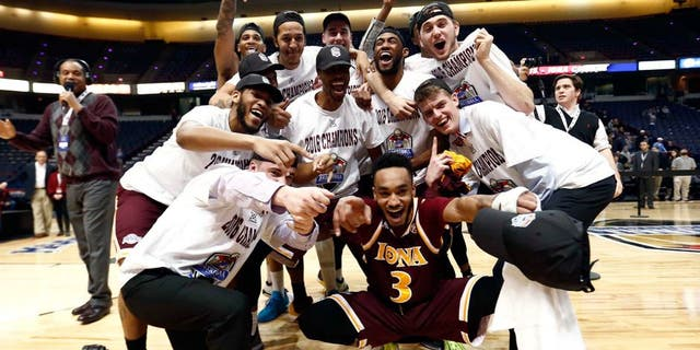 Mar 7, 2016; Albany, NY, USA; Iona Gaels guard Ibn Muhammad (3) and the rest of the team celebrate after defeating the Monmouth Hawks in the MAAC conference tournament finals at Times Union Center. Mandatory Credit: Mark L. Baer-USA TODAY Sports
