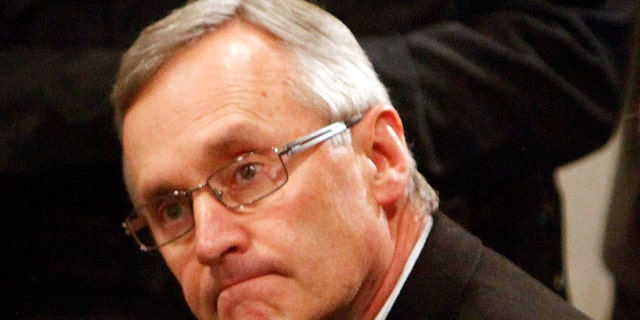 March 8: Ohio State football coach Jim Tressel, left, sits next to E. Gordon Gee, Ohio State University president, during a news conference in Columbus, Ohio.