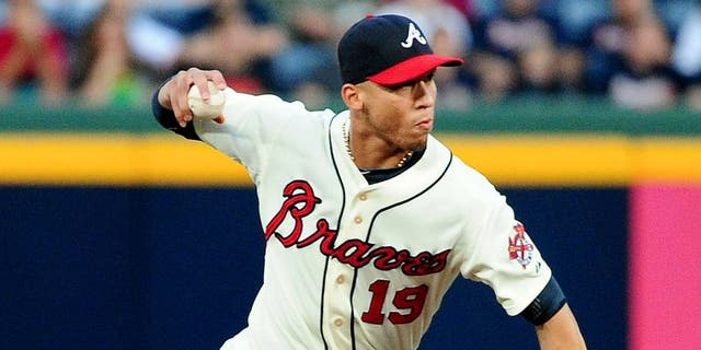 ATLANTA, GA - SEPTEMBER 14: Andrelton Simmons #19 of the Atlanta Braves makes a throw against the San Diego Padres at Turner Field on September 14, 2013 in Atlanta, Georgia. (Photo by Scott Cunningham/Getty Images)