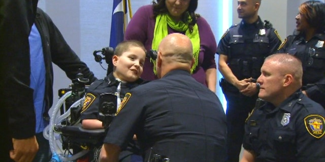 Dakin Lovelace was recognized for his bravery during a ceremony with the Fort Worth Police Department.