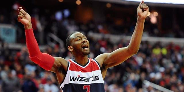 Mar 14, 2015; Washington, DC, USA; Washington Wizards guard John Wall (2) celebrates against the Sacramento Kings during the fourth quarter at Verizon Center. Mandatory Credit: Brad Mills-USA TODAY Sports