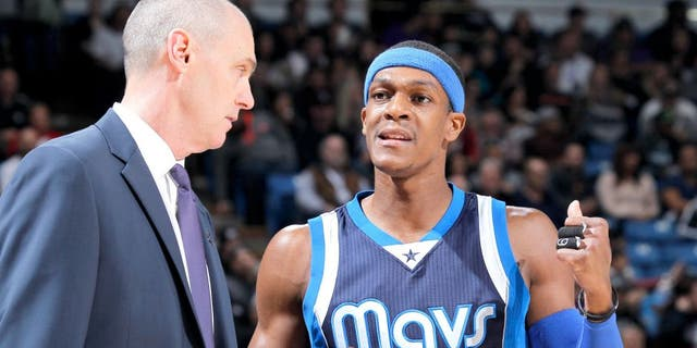 SACRAMENTO, CA - JANUARY 13: Head Coach Rick Carlisle of the Dallas Mavericks coaches Rajon Rondo #9 against the Sacramento Kings on January 13, 2015 at Sleep Train Arena in Sacramento, California. NOTE TO USER: User expressly acknowledges and agrees that, by downloading and or using this photograph, User is consenting to the terms and conditions of the Getty Images Agreement. Mandatory Copyright Notice: Copyright 2015 NBAE (Photo by Rocky Widner/NBAE via Getty Images)