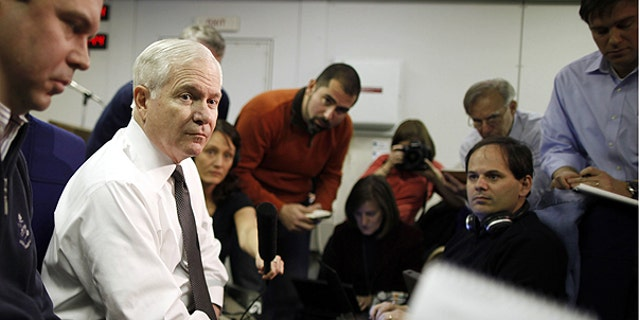 March 20: U.S. Defense Secretary Robert Gates speaks about Libya as he briefs reporters on board a military plane en route to St. Petersburg, Russia.