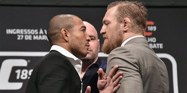 RIO DE JANEIRO, BRAZIL - MARCH 20: UFC Featherweight Champion Jose Aldo of Brazil (L) and challenger Conor McGregor face off as UFC President Dana White (C) stands in during the 189 World Media Tour Launch press conference at Maracanazinho on March 20, 2015 in Rio de Janeiro, Brazil. (Photo by Buda Mendes/Zuffa LLC/Zuffa LLC via Getty Images)
