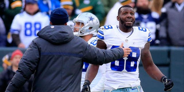 Dez Bryant #88 of the Dallas Cowboys waits for a replay on a call late in the fourth quarter against the Green Bay Packers during the 2015 NFC Divisional Playoff game at Lambeau Field on January 11, 2015 in Green Bay, Wisconsin. (Photo by Rob Carr/Getty Images)