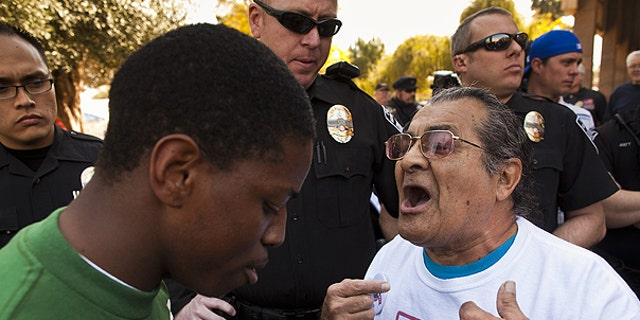 Feb. 22: arvis Johnson, leftt, , a supporter of immigrants' rights and Arthur Olivas, right, a supporter of Sen Russell Pearce's anti-immigrant bills, debate at the State Capitol in Phoenix.