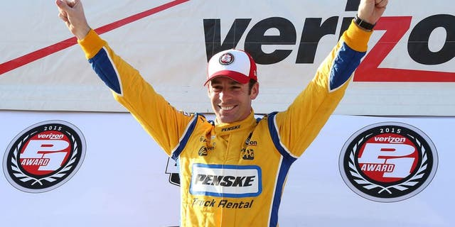 FONTANA, CA - JUNE 26: Race car driver Simon Pagenaud celebrates for winning the Pole Position of the Indy Car MAVTV 500 race at the Auto Club Speedway on June 26, 2015 in Fontana, California. (Photo by Frederick M. Brown/Getty Images)