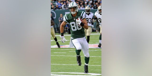 """FILE - In this Nov. 3, 2013, file photo, New York Jets wide receiver David Nelson runs during the first half of an NFL football game against the New Orleans Saints, in East Rutherford, N.J.  Nelson has been mad at the Buffalo Bills for months. Since Feb. 24, to be exact. That's when the Jets wide receiver heard that the Bills elected not to tender him, a restricted free agent, a contract offer. His three-year career with Buffalo was over _ and it was the way he got the news that riled him up.""""I found out through Twitter,"""" Nelson recalled Monday, Nov. 11, 2013, """"like a lot of other things in life."""" (AP Photo/Bill Kostroun, File)"""