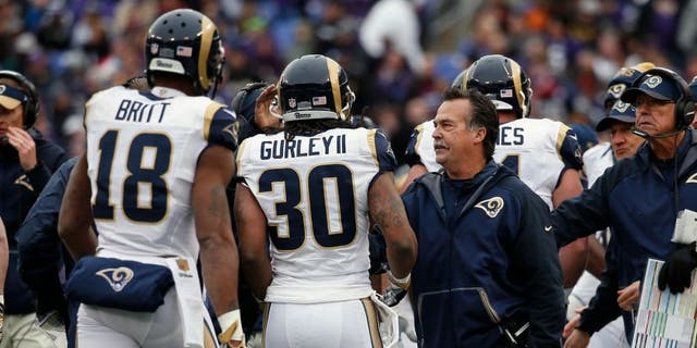 BALTIMORE, MD - NOVEMBER 22: Running back Todd Gurley #30 of the St. Louis Rams celebrates after scoring a first quarter touchdown against the Baltimore Ravens with wide receiver Kenny Britt #18 of the St. Louis Rams and head coach Jeff Fisher of the St. Louis Rams at M&T Bank Stadium on November 22, 2015 in Baltimore, Maryland. (Photo by Rob Carr/Getty Images)