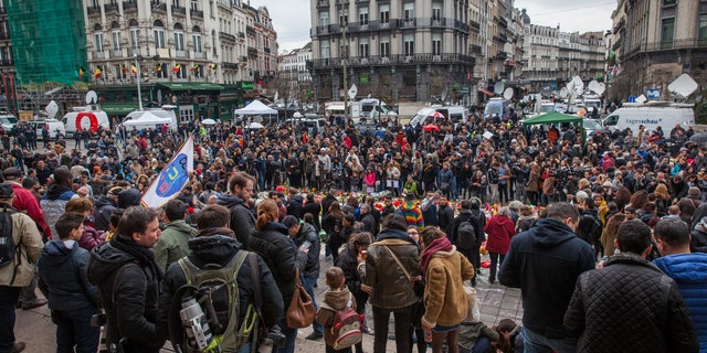 Crowds gather in the wake of the Belgium terror attacks for a public memorial.