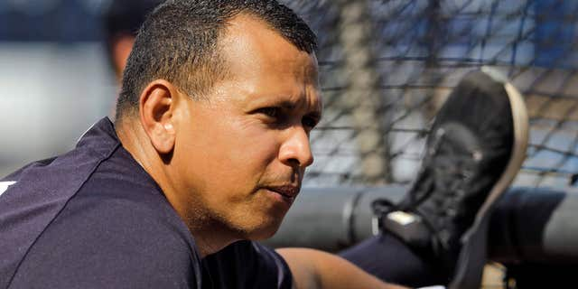 New York Yankees' Alex Rodriguez stretches on the batting cage while warming before a spring training baseball game against the Toronto Blue Jays, Wednesday, March 16, 2016, in Tampa, Fla.