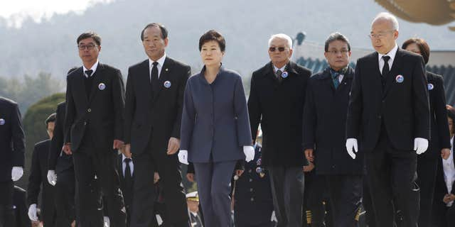 """March 25, 2016: South Korean President Park Geun-hye, center, attends """"West Sea Protection Day,"""" a memorial and national security awareness ceremony at Daejeon National Cemetery in Daejeon, South Korea."""