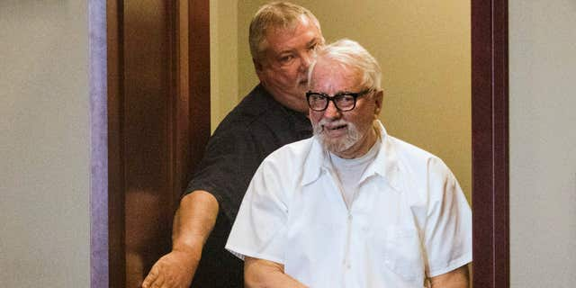 FILE - In this Jan. 14, 2016 file photo, convicted murderer Jack McCullough walks into the DeKalb County Courthouse in Sycamore, Ill., to request post-conviction relief.