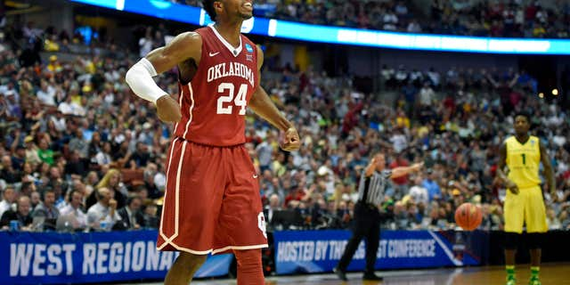 Oklahoma guard Buddy Hield celebrates after scoring during the first half of an NCAA college basketball game against Oregon in the regional finals of the NCAA Tournament, Saturday, March 26, 2016, in Anaheim, Calif.