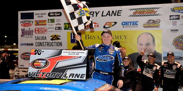 GREENVILLE, SC - MARCH 26: Justin Haley, driver of the #5 Braun Auto Chevrolet, celebrates in Victory Lane after winning the NASCAR K&N Pro Series East Kevin Whitaker Chevrolet 150 at Greenville Pickens Speedway on March 26, 2016 in Greenville, South Carolina. (Photo by Grant Halverson/NASCAR via Getty Images)