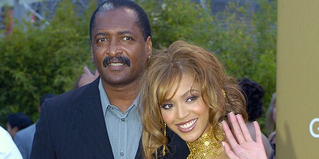 Beyonce Knowles (L) arrives at the 46th Annual Grammy Awards with her father and manager Mathew Knowles in Los Angeles.