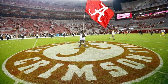 TUSCALOOSA, AL - SEPTEMBER 13: Big Al, mascot of the Alabama Crimson Tide, waves the flag after their 52-12 win over the Southern Miss Golden Eagles at Bryant-Denny Stadium on September 13, 2014 in Tuscaloosa, Alabama. (Photo by Kevin C. Cox/Getty Images)