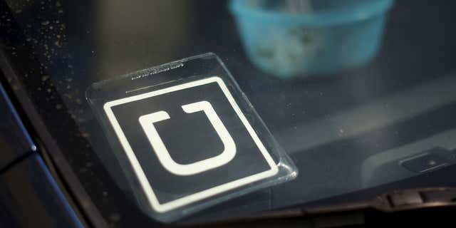 July 15, 2015: An Uber car is seen parked with the driver's lunch left on the dashboard in Venice, Los Angeles.