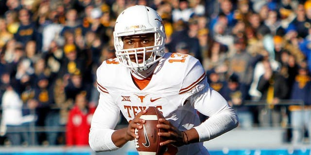 MORGANTOWN, WV - NOVEMBER 14: Jerrod Heard #13 of the Texas Longhorns in action during the game against the West Virginia Mountaineers on November 14, 2015 at Mountaineer Field in Morgantown, West Virginia. (Photo by Justin K. Aller/Getty Images)