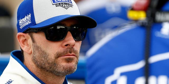 AVONDALE, AZ - MARCH 11: Jimmie Johnson, driver of the #48 Lowe's Pro Services Chevrolet, talks to a crew member on the grid during qualifying for the NASCAR Sprint Cup Series Good Sam 500 at Phoenix International Raceway on March 11, 2016 in Avondale, Arizona. (Photo by Daniel Shirey/Getty Images)