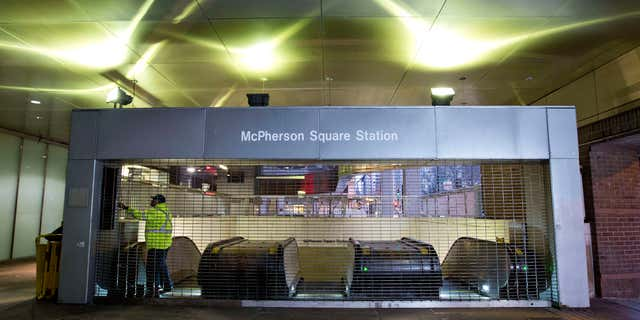 March 16, 2016: Metro employee shuts down escalators to the McPherson Square Station in Washington.