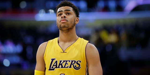 FILE - In this March 4, 2016, file photo, Los Angeles Lakers' D'Angelo Russell makes his way down the court during the first half of an NBA basketball game against the Atlanta Hawks, in Los Angeles.