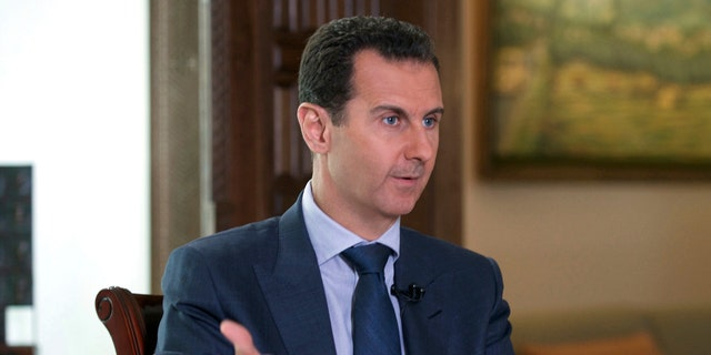 FILE -- In this Wednesday, Sept. 21, 2016 file photo released by the Syrian Presidency, Syrian President Bashar Assad speaks to The Associated Press at the presidential palace in Damascus, Syria.
