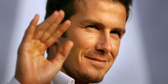 FILE - In this Dec. 29, 2006 file photo, Real Madrid soccer star David Beckham waves to fans during a promotional event in Tokyo. Beckham says he is retiring from soccer at the end of the season. The 38-year-old Beckham recently won a league title in a fourth country with Paris Saint-Germain. He has become a global superstar since starting his career at Manchester United.  (AP Photo/David Guttenfelder, File)