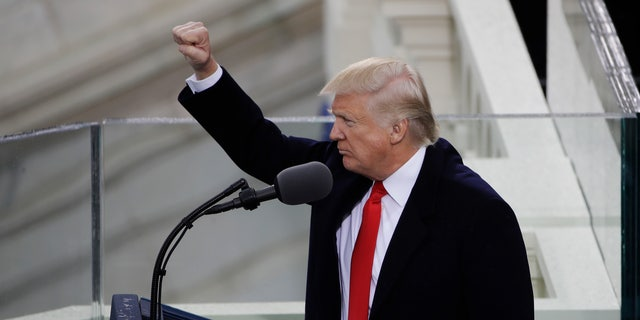 President Donald Trump pumps his fist after delivering his inaugural address after being sworn in as the 45th president of the United States during the 58th Presidential Inauguration at the U.S. Capitol in Washington, Friday, Jan. 20, 2017. (AP Photo/Matt Rourke)