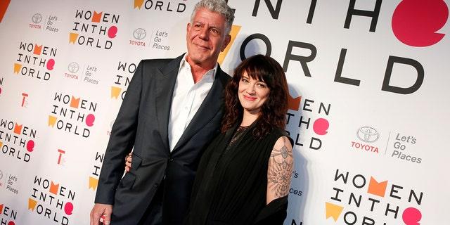 Bourdain posing with his girlfriend Asia Argento.