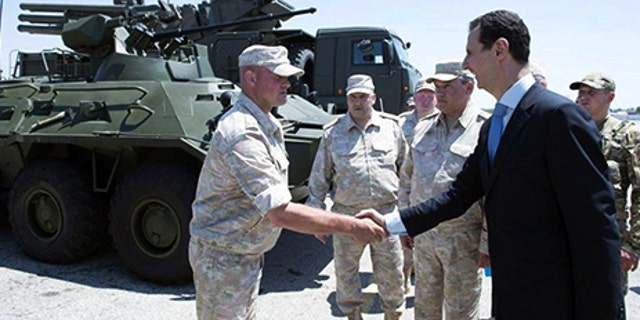 Syria's President Bashar al-Assad visits a Russian air base at Hmeymim, in western Syria in this handout picture posted on SANA on June 27, 2017, Syria. SANA/Handout via REUTERS ATTENTION EDITORS - THIS PICTURE WAS PROVIDED BY A THIRD PARTY. REUTERS IS UNABLE TO INDEPENDENTLY VERIFY THE AUTHENTICITY, CONTENT, LOCATION OR DATE OF THIS IMAGE - RTS18TY5