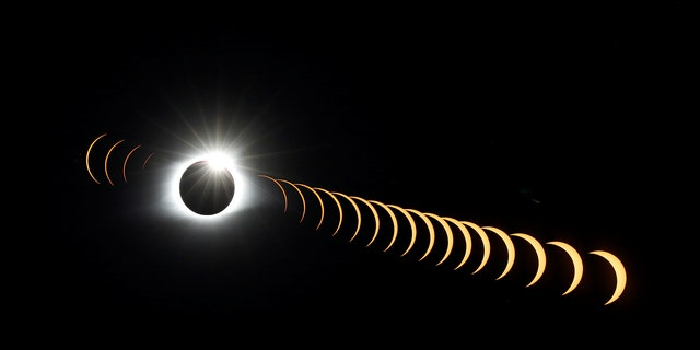"""A multiple exposure image shows the solar eclipse as it creates the effect of a diamond ring at totality as seen from Clingmans Dome, which at 6,643 feet (2,025m) is the highest point in the Great Smoky Mountains National Park, Tennessee, U.S. August 21, 2017. Location coordinates for this image are 35º33'24"""" N, 83º29'46"""" W. REUTERS/Jonathan Ernst     TPX IMAGES OF THE DAY - RTS1CPZ5"""