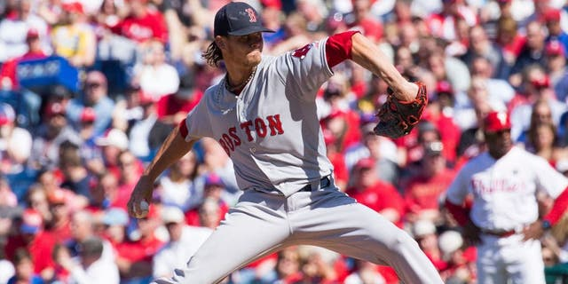 Apr 6, 2015; Philadelphia, PA, USA; Boston Red Sox starting pitcher Clay Buchholz (11) pitches against the Philadelphia Phillies during the first inning on opening day at Citizens bank Park. Mandatory Credit: Bill Streicher-USA TODAY Sports