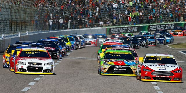 FORT WORTH, TX - NOVEMBER 08: Brad Keselowski, driver of the #2 Wurth Ford, leads the field past the green flag to start the NASCAR Sprint Cup Series AAA Texas 500 at Texas Motor Speedway on November 8, 2015 in Fort Worth, Texas. (Photo by Jonathan Ferrey/Getty Images for Texas Motor Speedway)