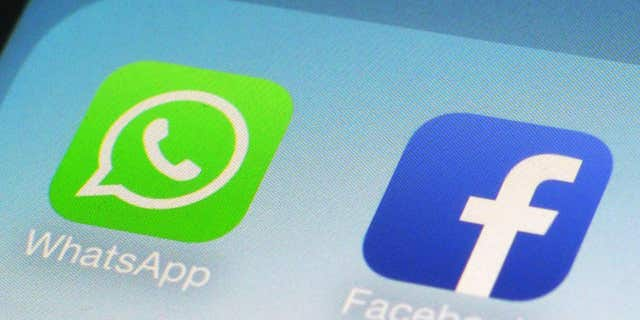 FILE - This Feb. 19, 2014, file photo, shows WhatsApp and Facebook app icons on a smartphone in New York.