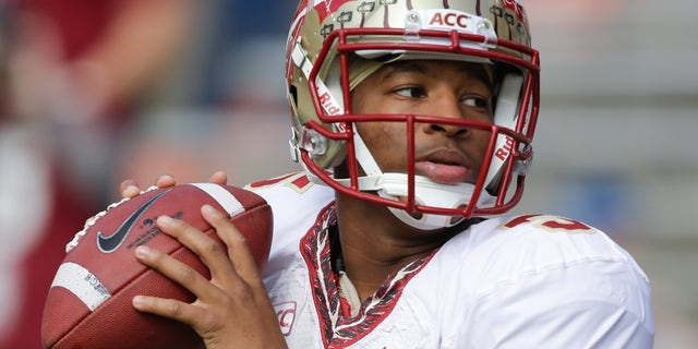 FILE - In this Nov. 30, 2013, file photo, Florida State quarterback Jameis Winston warms up before an NCAA college football game against Florida in Gainesville, Fla. The prosecutor overseeing the investigation of sexual assault allegations against Winston says it is completed. State Attorney Willie Meggs has scheduled a news conference at 2 p.m. Thursday, Dec. 5, 2013, in his office to announce his findings. (AP Photo/John Raoux, File)