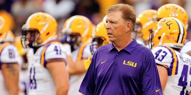 BATON ROUGE, LA - SEPTEMBER 07: Cam Cameron, offensive coordinator of the LSU Tigers, watches his team during warmups prior to a game at Tiger Stadium against the UAB Blazers on September 7, 2013 in Baton Rouge, Louisiana. LSU won the game 56-17. (Photo by Stacy Revere/Getty Images)
