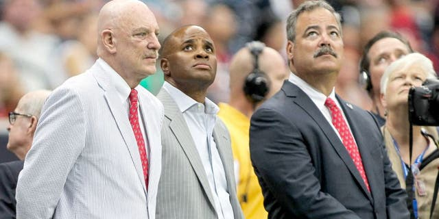 Aug 16, 2014; Houston, TX, USA; Houston Texans owner Bob McNair (left) and general manager Rick Smith (middle) and chief operating officer Cal McNair (right) watch during the first quarter against the Atlanta Falcons at NRG Stadium. Mandatory Credit: Troy Taormina-USA TODAY Sports