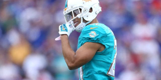 ORCHARD PARK, NY - SEPTEMBER 14: Brent Grimes #21 of the Miami Dolphins during NFL game action against the Buffalo Bills at Ralph Wilson Stadium on September 14, 2014 in Orchard Park, New York. (Photo by Tom Szczerbowski/Getty Images)