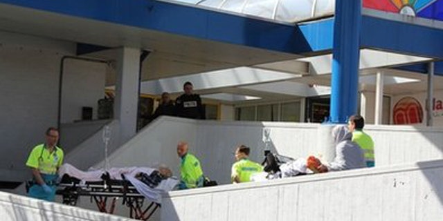 April 9: Injured people are carried out of a shopping mall after a shooting in Alpen aan den Rijn, Netherlands.