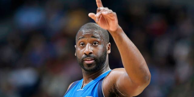 Dallas Mavericks guard Raymond Felton gestures after hitting a basket against the Denver Nuggets in the third quarter of an NBA basketball game Friday, April 10, 2015, in Denver. Dallas won 144-143 in two overtimes. Felton ended up scoring the winning basket. (AP Photo/David Zalubowski)