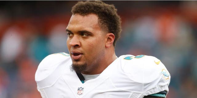 Nov 23, 2014; Denver, CO, USA; Miami Dolphins guard Mike Pouncey (51) before the game against the Denver Broncos at Sports Authority Field at Mile High. Mandatory Credit: Chris Humphreys-USA TODAY Sports