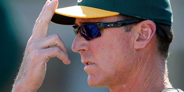Mar 23, 2015; Goodyear, AZ, USA; Oakland Athletics manager Bob Melvin (6) gives out signs in the first inning against the Cleveland Indians during a spring training game at Goodyear Ballpark. Mandatory Credit: Rick Scuteri-USA TODAY Sports