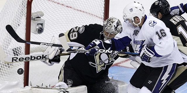 April 13: Pittsburgh Penguins goalie Marc-Andre Fleury (29) blocks a shot by Tampa Bay Lightning's Teddy Purcell (16) in the first period of Game 1 of a first-round NHL hockey playoff series in Pittsburgh.