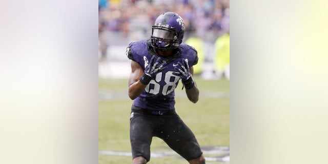 TCU wide receiver Cam White (88) reacts after a pass slipped through his hands during a rain shower in the second half of an NCAA college football game against SMU Saturday, Sept. 28, 2013, in Fort Worth, Texas. TCU won 48-17.(AP Photo/Brandon Wade)
