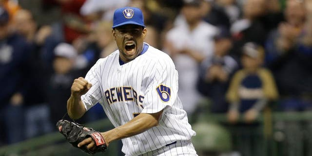 MILWAUKEE, WI - APRIL 12: Francisco Rodriguez #57 of the Milwaukee Brewers celebrates after the 3-2 win over the Pittsburgh Pirates at Miller Park on April 12, 2014 in Milwaukee, Wisconsin. (Photo by Mike McGinnis/Getty Images)