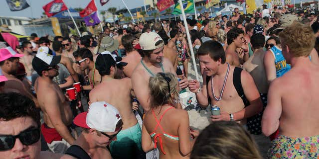 March 25, 2015: Party goers fill the sand behind Club La Vela and Spinnaker Beach Club during the fourth week of spring break.