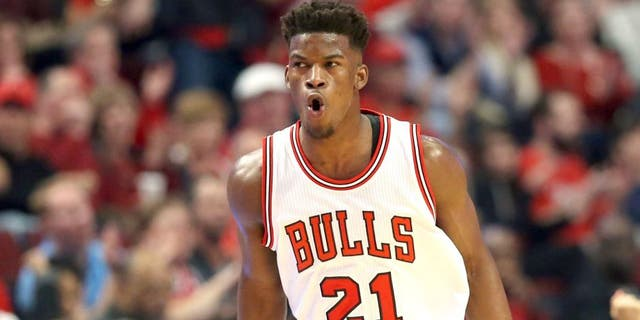 Apr 18, 2015; Chicago, IL, USA; Chicago Bulls guard Jimmy Butler (21) reacts after making a three-point basket against the Milwaukee Bucks during the first quarter in game one of the first round of the 2015 NBA Playoffs at United Center. Mandatory Credit: Jerry Lai-USA TODAY Sports