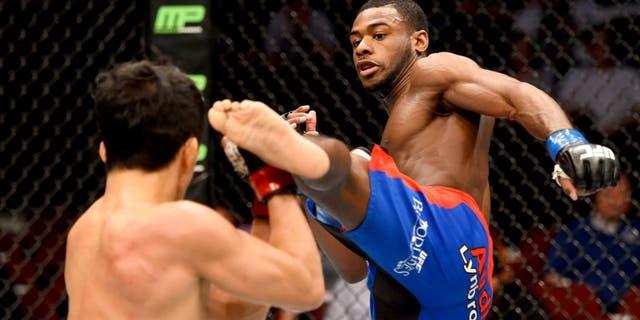 NEWARK, NJ - APRIL 18: Aljamain Sterling (R) kicks Takeya Mizugaki of Japan in their bantamweight bout during the UFC Fight Night event at Prudential Center on April 18, 2015 in Newark, New Jersey. (Photo by Josh Hedges/Zuffa LLC/Zuffa LLC via Getty Images)